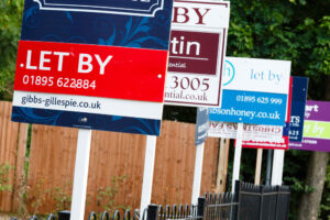 A row of estate agents for sale boards